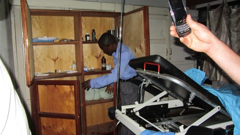 CSCODI doctor showing us the barren supply cabinet