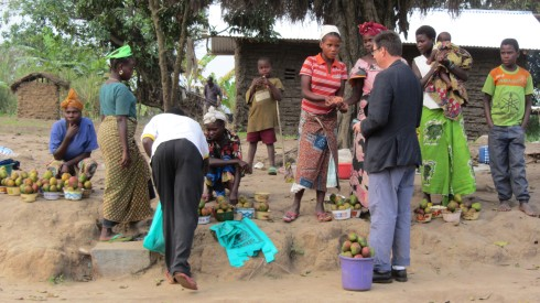 Michael Ben negotiating for mangoes on the road to Bunia