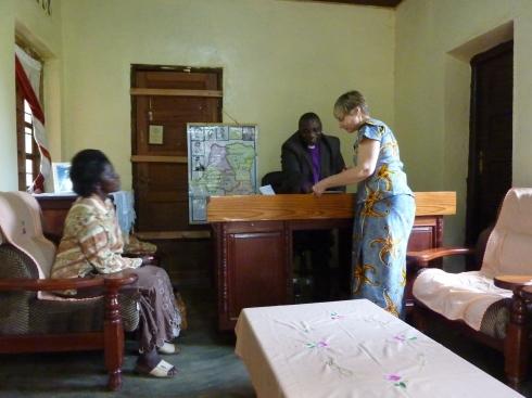 Brenda Ben with Bishop Isesomo Muhindo