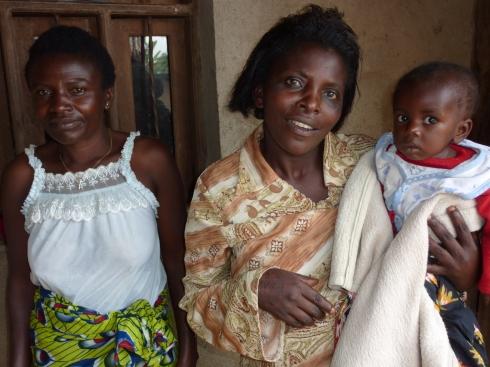 Mama Dorcas with an orphan and a helper