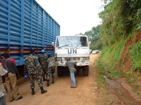 Trying to get the UN truck out of the way.  We wound up squeezing by on the right.