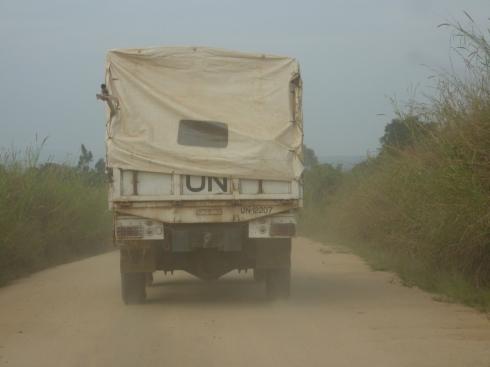 Behind a UN troop carrier