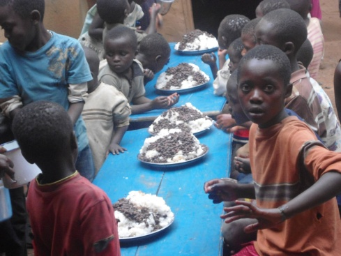 Enjoying the goat and a good source of protein.  Meat is a rare treat for the orphans