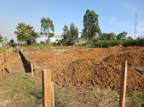 Foundation for one medical amphitheatre.  In the background is the ISTM house where the Wood's are currently staying