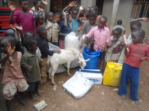 Compassion for Children in Distress Orphanage in Butembo receiving supplies including a goat and saying Jambo to us.