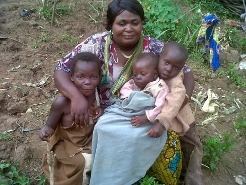 Saasita with orphans from the ADF / Nalu conflict