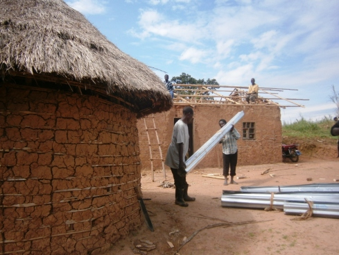 Repairing the roof at the Kalondo Health Clinic near Butembo DRC