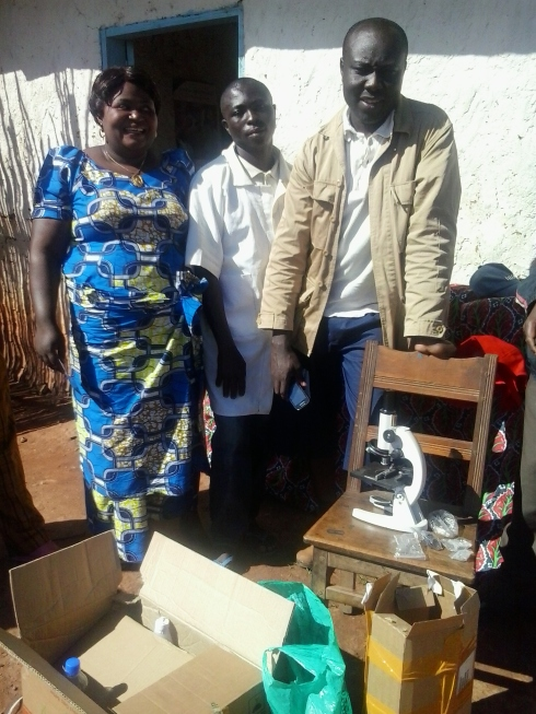 Mama Saasita with a Kalondo volunteer and James Kataliko