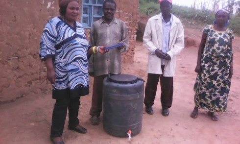 Giving soap and a tank to the health committee leaders