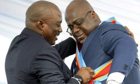 kabila wraps presidential sash around tshisekedi